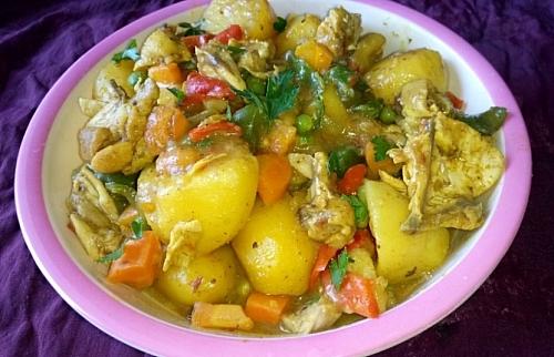 Rich yummy chicken and curried potato porridge