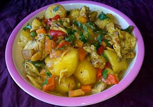 Serving chicken curried potato porridge
