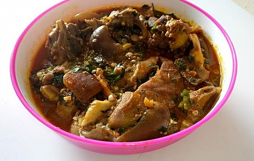 A plate of delicious ogbono soup made with okra and uziza leaves