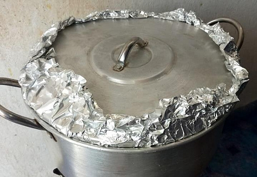 The foil paper help to trap in heat in the pot and hasten the cooking process without the rice turning soggy