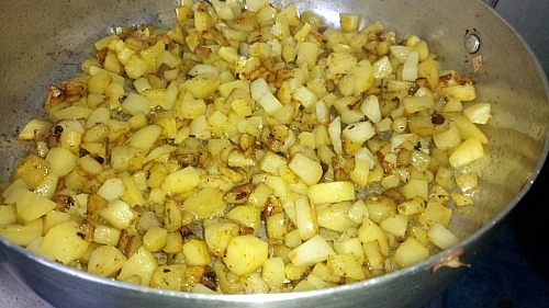 Fry the potatoes until they start to get brown, then flip to cook underneath