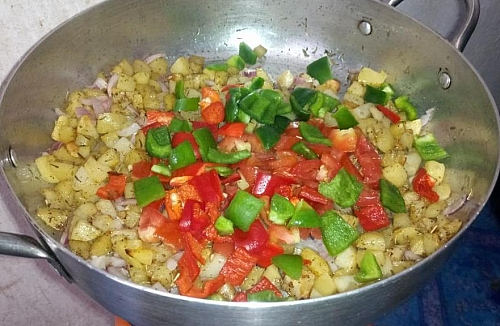 Add the bell peppers stir all to combine, these will add some crunch to the stir fry potatoes
