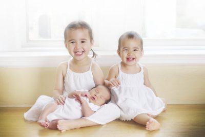 older siblings and newborn
