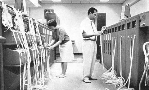Paper tape relay operation at US FAA's Honolulu flight service station in 1964 showing a large number of punch tapes
