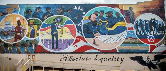 Mural of Gordon Granger signing the Special orders with African American soldiers looking on