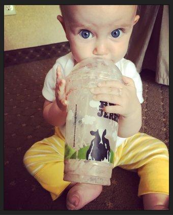 Lizzie drinking a milkshake