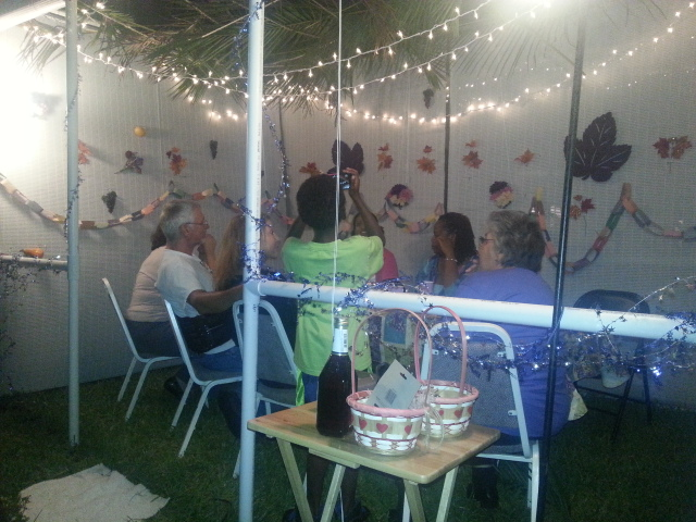 study group dwelling together in the sukkah