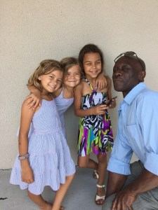 """The girls, their adopted """"sister"""" and our neighbor, Mike."""