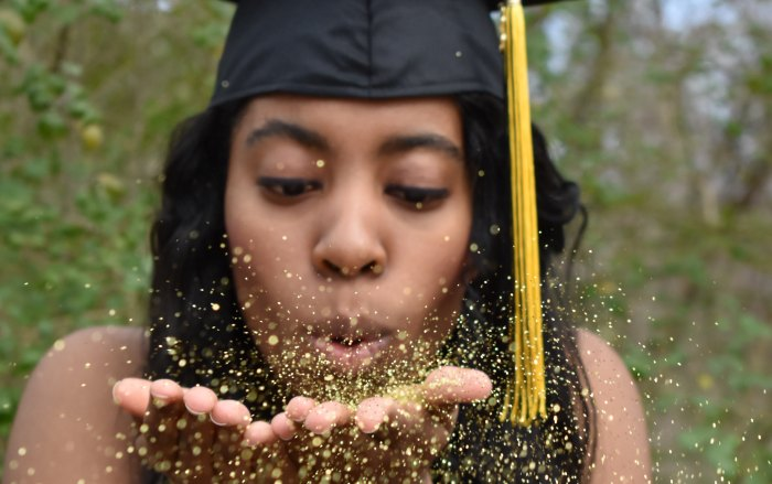 woman graduating with glitter
