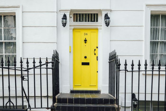 a yellow door in a street