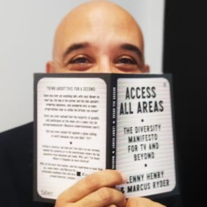 Bald man holding book titled Access All Areas