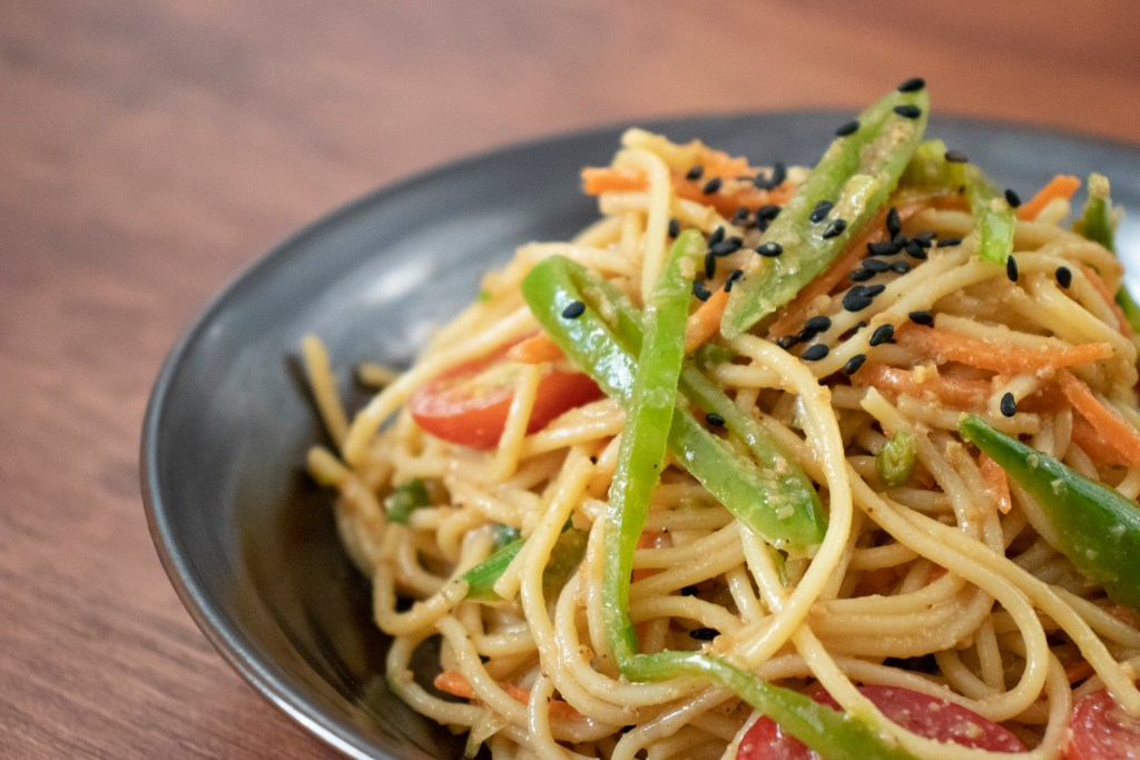 A closeup of a sesame noodle salad dish made with Jovian Pantry® Sesame Dressing.