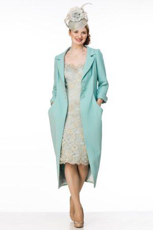 Wool crepe coat over corded metallic lace dress