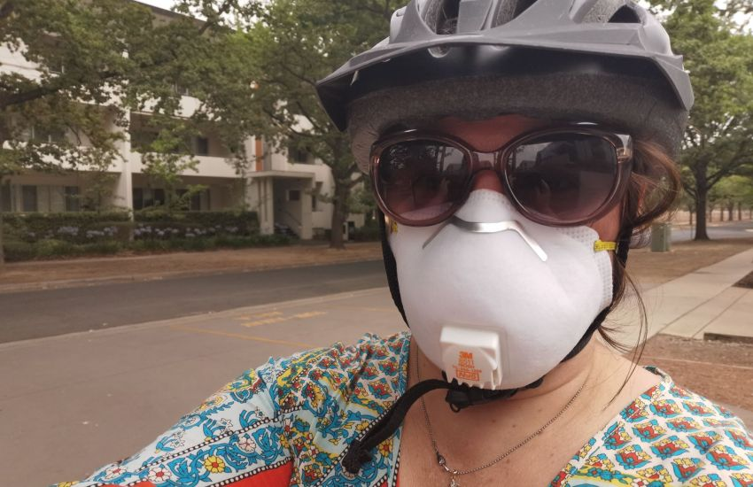 Serina wearing a face mask and bicycle helmut