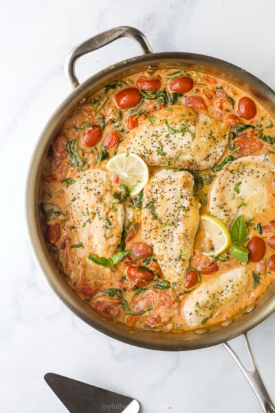 overhead photo of creamy tuscan chicken in a pan