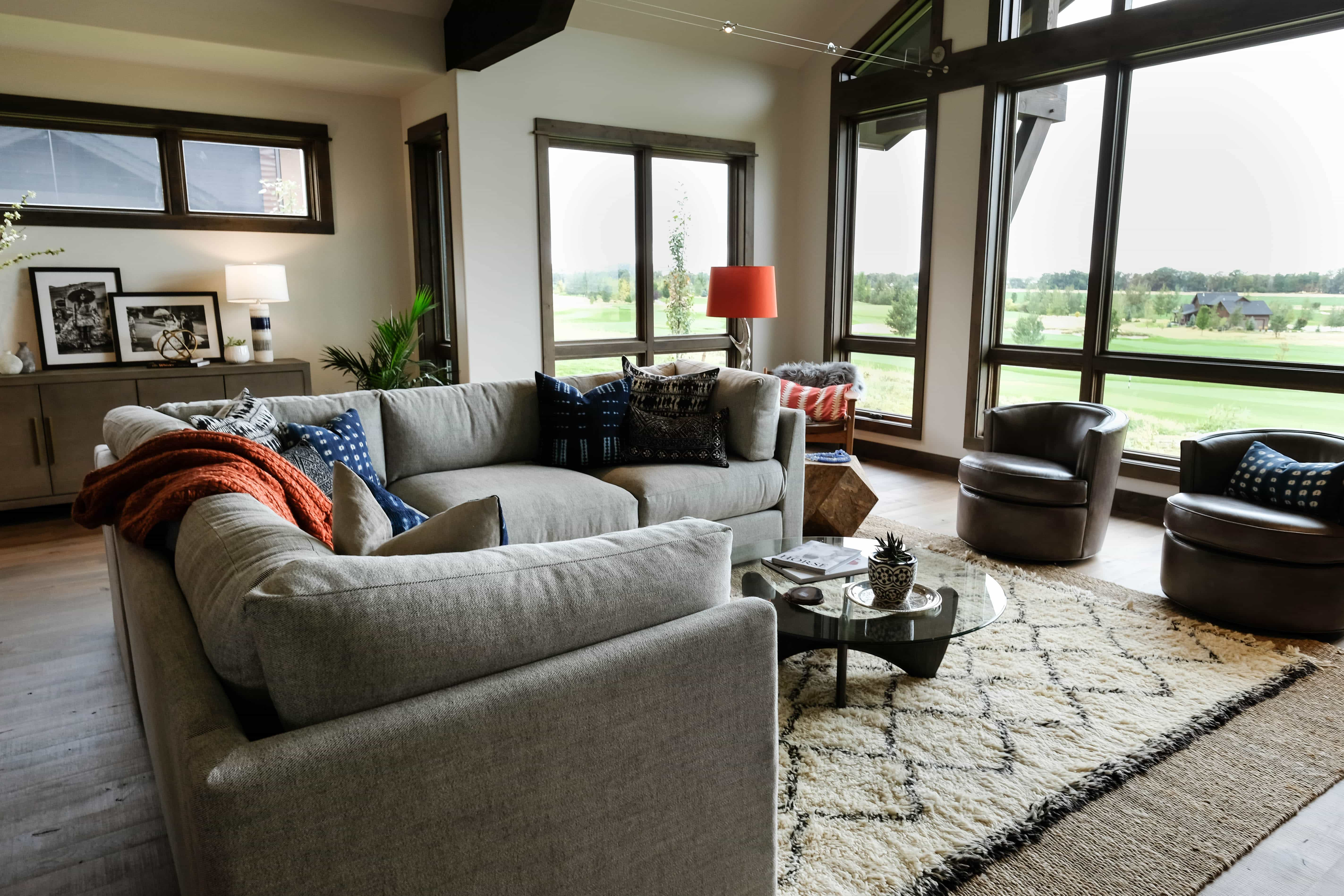 Parade of Homes living room with couch, chairs, and rug