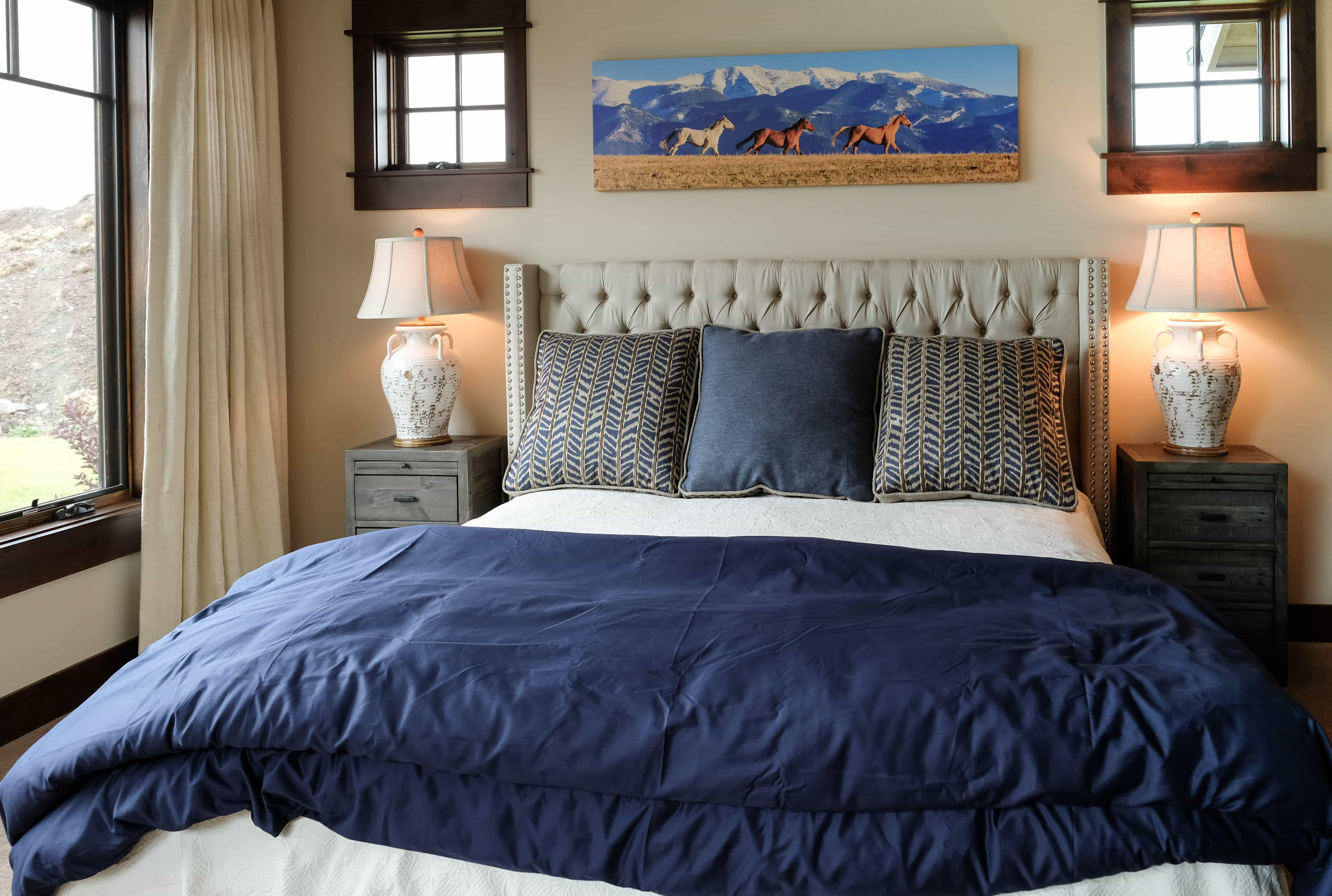 Parade of Homes bedroom with tan headboard, nightstands and lamps