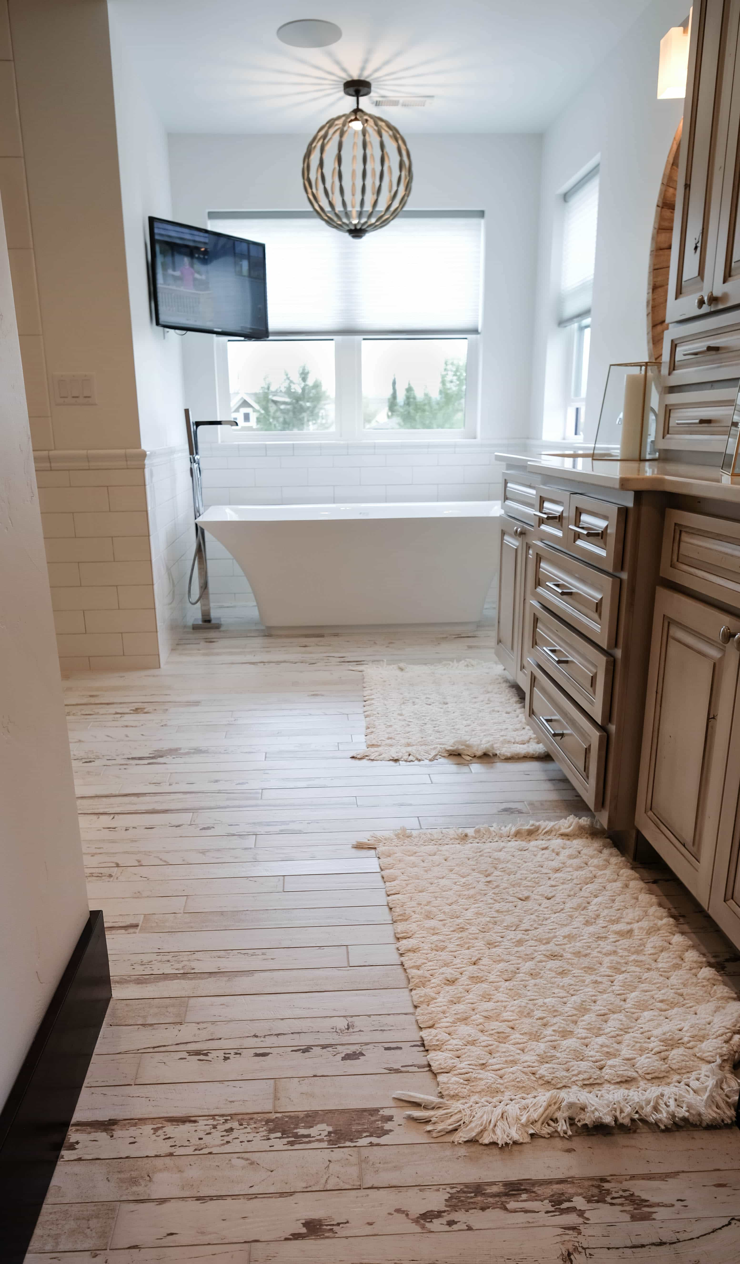 Parade of Homes Master bathroom with rustic barnwood floor