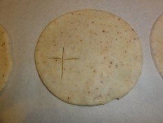 6. Cut a cross-shape into one side of each circle of dough.