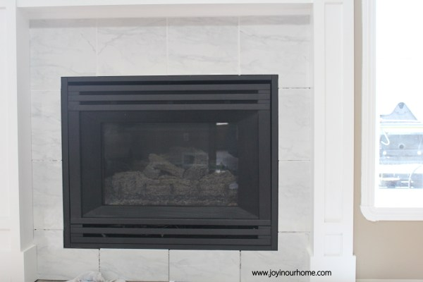 Easy Spray Paint Fireplace Makeover at www.joyinouhome.com