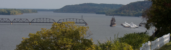 Photo of barge and open railroad bridge