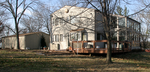 1970s built house with siding and deck