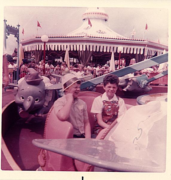 Two children on the Dumbo ride, Disney World, 1973