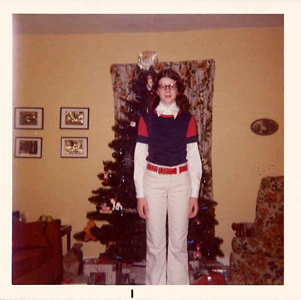 Girl in front of Christmas tree, circa 1975
