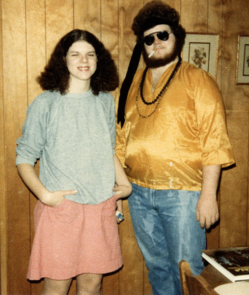 Young woman and man in sixties costumes.