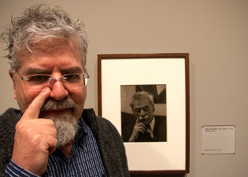 photo of Rick next to photographic portrait of Alfred Stieglitz taken by Paul Strand