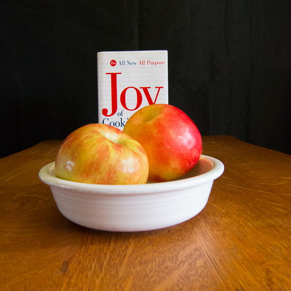 photo of two apples with The Joy of Cooking cookbook