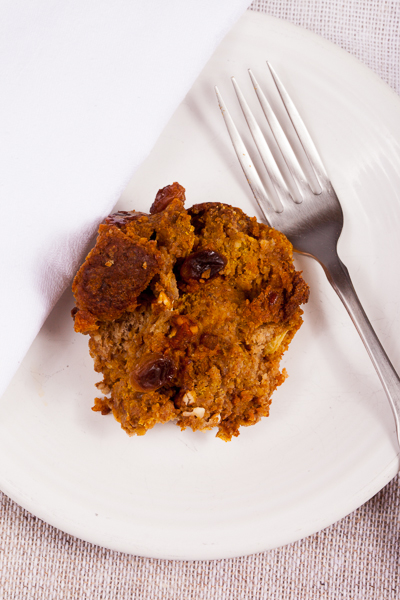 photo of Pumpkin Bread Pudding with fork and white napkin on white plate