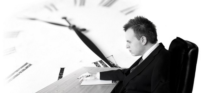 Desk worker stressed with long working hours