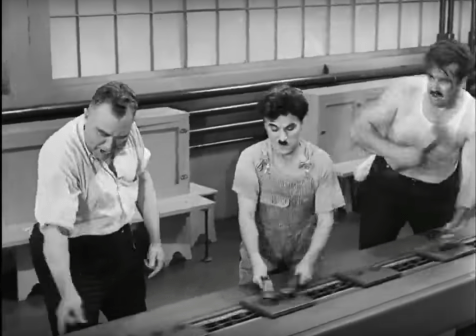 "Still shot from Charlie Chaplin's ""Modern Times"" illustrating high demands, low resources, no social support on an assembly line."