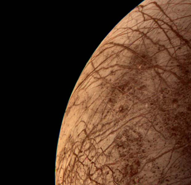 Europa During Voyager 2 Closest Approach (NASA), icy moon of Jupiter thought to have an ocean beneath its icy crust - one of the other possible locatiosn for life in our solar system