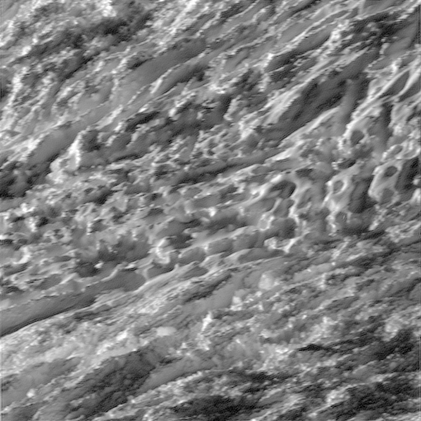 During its closest ever dive past the active south polar region of Saturn's moon Enceladus, NASA's Cassini spacecraft quickly shuttered its imaging cameras to capture glimpses of the fast moving terrain below. This view has been processed to remove slight smearing present in the original, unprocessed image that was caused by the spacecraft's fast motion.