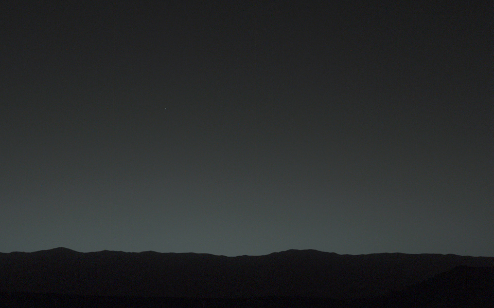 This view of the twilight sky and Martian horizon taken by NASA's Curiosity Mars rover includes Earth as the brightest point of light in the night sky. Earth is a little left of center in the image, and our moon is just below Earth.
