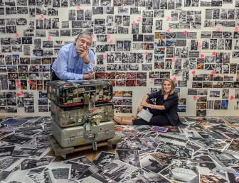 "June 25, 2013. Manhattan, New York. JP Laffont and his wife Eliane at their studio working on the layout for ""Photographer's Paradise""."