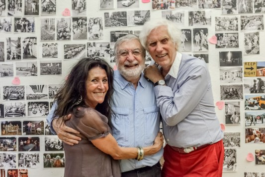 July 17, 2013. Manhattanm, New York. Jean-Pierre Laffont with Douglas Kirkland and wife Françoise in front of 'Photographer's Paradise' image wall, at Laffont's studio