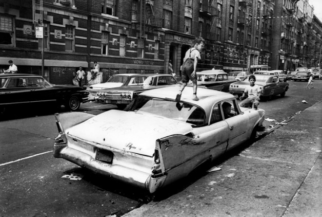 Bronx, New York City, NY. Summer of 1966. An abandoned car becomes a place for kids to play in Fox Street. From the mid-1960s to the late-1970s, quality of life for Bronx residents declined sharply.