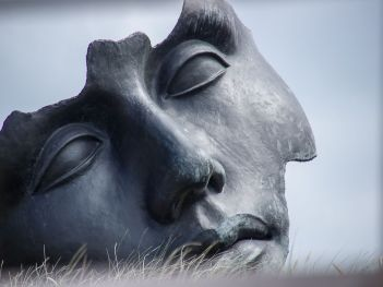 An art piece depicting a gray mask, transported after getting moving quotes Brooklyn.