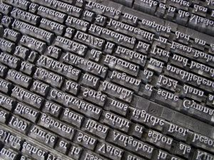 A led printing press mold with letters in English.