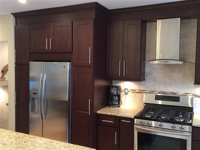 Maspeth Kitchen Ebony Cabinet With Gaillio Ornamental 1
