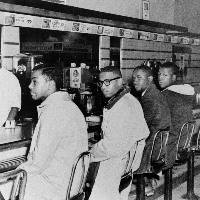 "(From left) Joseph McNeil and Franklin McCain, two of the Greensboro Four who the day before had sat at the ""whites only"" counter of a Woolworth store, came back on Feb. 2, 1960, with two others -- Billy Smith and Clarence Henderson."