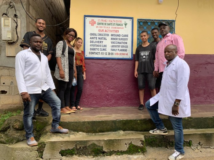 Markus Brooks, a senior criminal justice major, poses with members of the St. Francis Medical Center staff where he worked during his study-abroad experience in Cameroon. (Photo special to JSU)