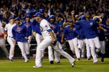 The Chicago Cubs celebrating their win against the St. Louis Cardinals in the National League Division Series in Chicago, Oct. 13, 2015. (Nam Y. Huh/AP Images)