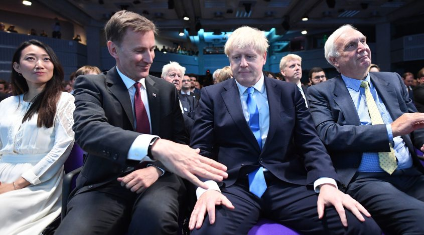 Foreign Secretary Jeremy Hunt, left, extending a hand to congratulate Boris Johnson for being elected as the new leader of the Conservative Party and British Prime Minister in London, the United Kingdom, on July 23,…</div> </div><!-- .entry-summary --> 			 				 <header class=