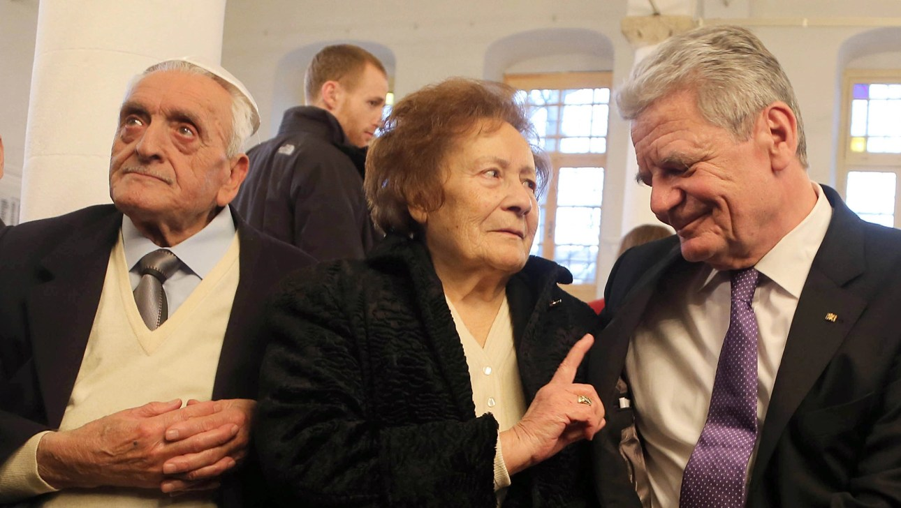 Esther Cohen sits near her husband Samuel, left, and German President Joachim Gauck in Ioannina, Greece on 07 March 2014. (Wolfgang Kumm/picture alliance via Getty Images)