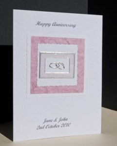 Rings On Old Rose Anniversary Card Angle - Ref P120)