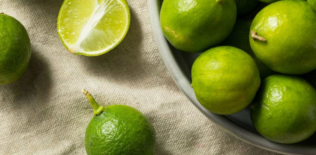 Key limes overflowing in a bowl